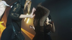 Girls in halloween costumes and face paint dancing on scene at night club party Stock Footage