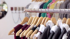 Stand with women's clothes in store Stock Footage