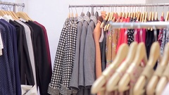 Women's clothing on a hanger in a boutique Stock Footage