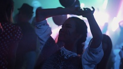 Girl in chain-mail and painted scar on cheek dance at night club halloween party Stock Footage
