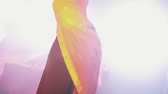 Woman in arabic dress do belly dance on scene at night club. Flashing lights Stock Footage