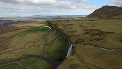 Iceland drone footage from Seljalandsfoss with propelled parachute Stock Footage