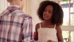 Girl Giving Birthday Present To Boy And Kissing Him Stock Footage