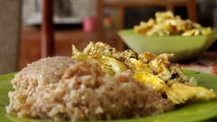 Fried Potatoes and Scrambled Eggs With Folk and Spoon in Geen Plate. Stock Footage