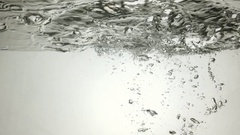 Cartridge case falling into the water with a velocity of 240 fps Stock Footage