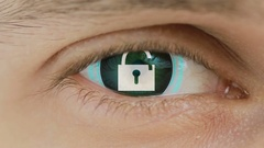 Close-up of eye with computer text overlayed. Zoom in centr. open lock sign. Stock Footage