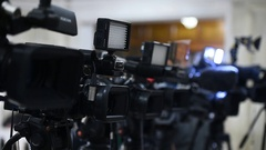 Lots of television cameras in a row broadcasting a live event Stock Footage
