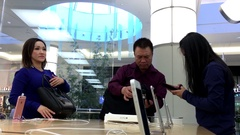 People buying iphone and paying credit card inside Apple store Stock Footage