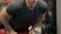 Young athletic man doing exercise in gym. The man swings a press in the gym. The Stock Footage