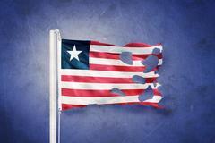 Torn flag of Liberia flying against grunge background Stock Illustration