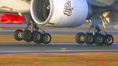 Stunning extrem close up of landing gear Boeing 777 touchdown runway Stock Footage