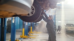 Car automobile service - mechanic checks the luxury SUV Stock Footage