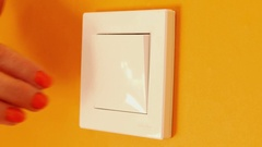 Close-up of hand pressing light switch on wall Stock Footage
