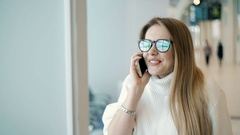 Businesswoman with mobile phone Stock Footage
