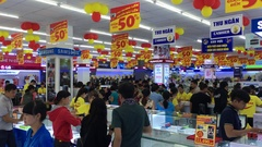 People rush to buy goods in electronics store on its opening day, Vietnam Stock Footage