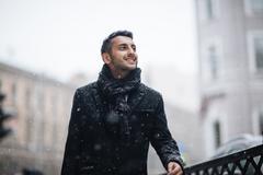 Joyous Arabic Man in Winter City Stock Photos
