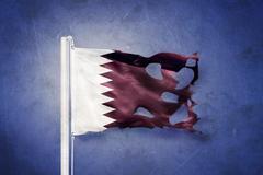 Torn flag of Qatar flying against grunge background Stock Illustration