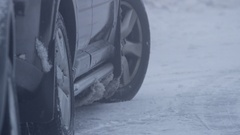 Car maneuver s on snow covered street Stock Footage