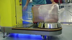Close Up Employee of the Airport Rewinds the Tape Passenger Suitcase Stock Footage