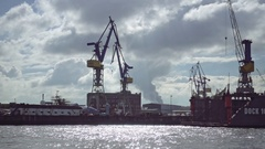 Container cranes and cargo boats in marin terminal Stock Footage