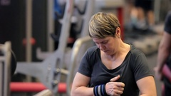 Close up of Athletic woman sweating taking a break after work out.The girl has a Stock Footage