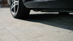 Close-up - the woman in high heels get out from the car Stock Footage