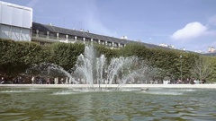 Running fountain surrounded by green trees Stock Footage