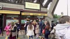 Tourists in queue to Eiffel Tower ticket office Stock Footage