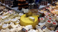 Variety of cheese in a deli cooler in a grocery store Stock Footage