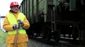 Railway worker looks at the passing train HD Footage