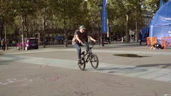 Young man ride bmx bike on back wheel Stock Footage