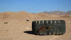Big tyre lies in desert near Aqaba, Jordan Stock Footage