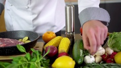 Chef preparing beef steak for cooking in kitchen Stock Footage