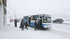 Group of people sit in public city bus during snowfall (snowstorm) Stock Footage