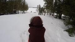 Sledding woman and her big mastiff dog on toboggan go pro crash and fall Stock Footage