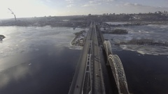 Flying over the railway bridge, at the bottom of the car ride, the river was Stock Footage