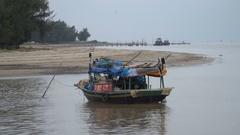 Vietnamese fishing boats near the shore Stock Footage