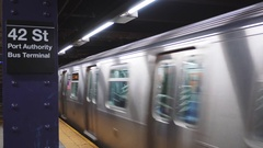 Subway train leaving 42 street station near Port Authority Bus Terminal in New Stock Footage