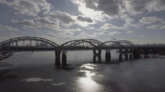 Shooting with air, railway bridge near the car ride, the river is covered with Stock Footage