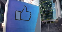 Street signage board with Facebook like button thumb up Stock Footage