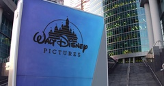 Street signage board with Walt Disney Pictures logo. Modern office center Arkistovideo