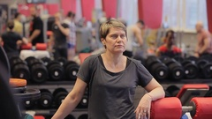 Close up of Athletic woman sweating taking a break after work out. The girl Stock Footage