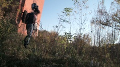 Man sets retro camera in the forest Stock Footage
