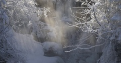 Frozen waterfall and rays of sun Stock Footage