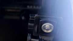 Man adjusts the retro camera close-up Stock Footage