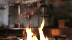 Open Flame Sparks above Gas Stove from Poured Cinnamon Stock Footage