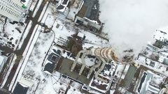 4K Aerial. Pipe of city power plant with smoke, top view, lateral flight Stock Footage