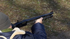 A Man Shooting From a Pump-Action Gun. Slow Motion. Stock Footage
