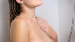 Slow motion of sexy young woman touching her body at shower Stock Footage