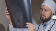Two doctors in hospital corridor study of x-ray picture of the patient Stock Footage